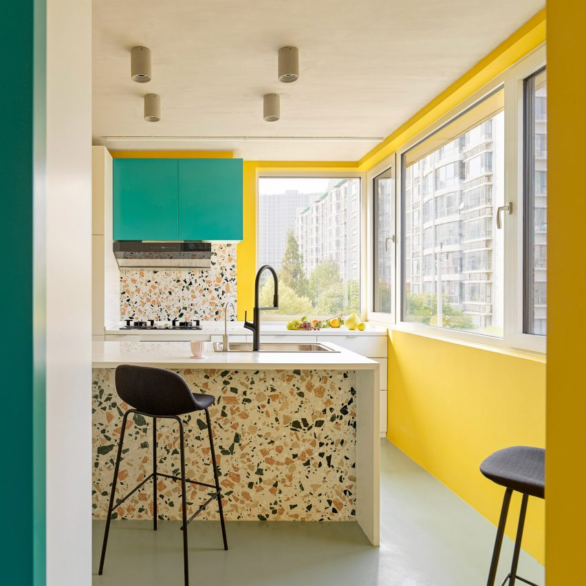 Bright yellow and turquoise kitchen