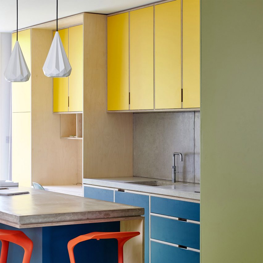 Multi-coloured kitchen with concrete countertops