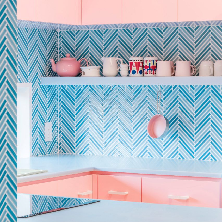 Bubblegum-pink kitchen with parquet blue tiles