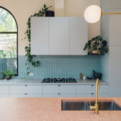 Duck-egg blue kitchen with pink terrazzo breakfast bar