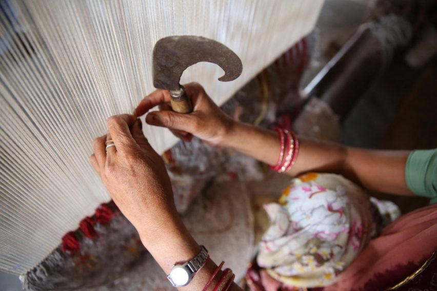 Deepak being hand-knotted in the Jaipur Rugs factory