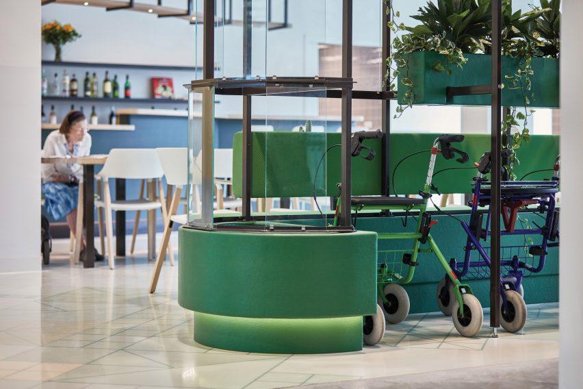 Walker parking with planter at Domstate Zorghotel rehabilitation centre by by Van Eijk & Van der Lubbe, Utrecht