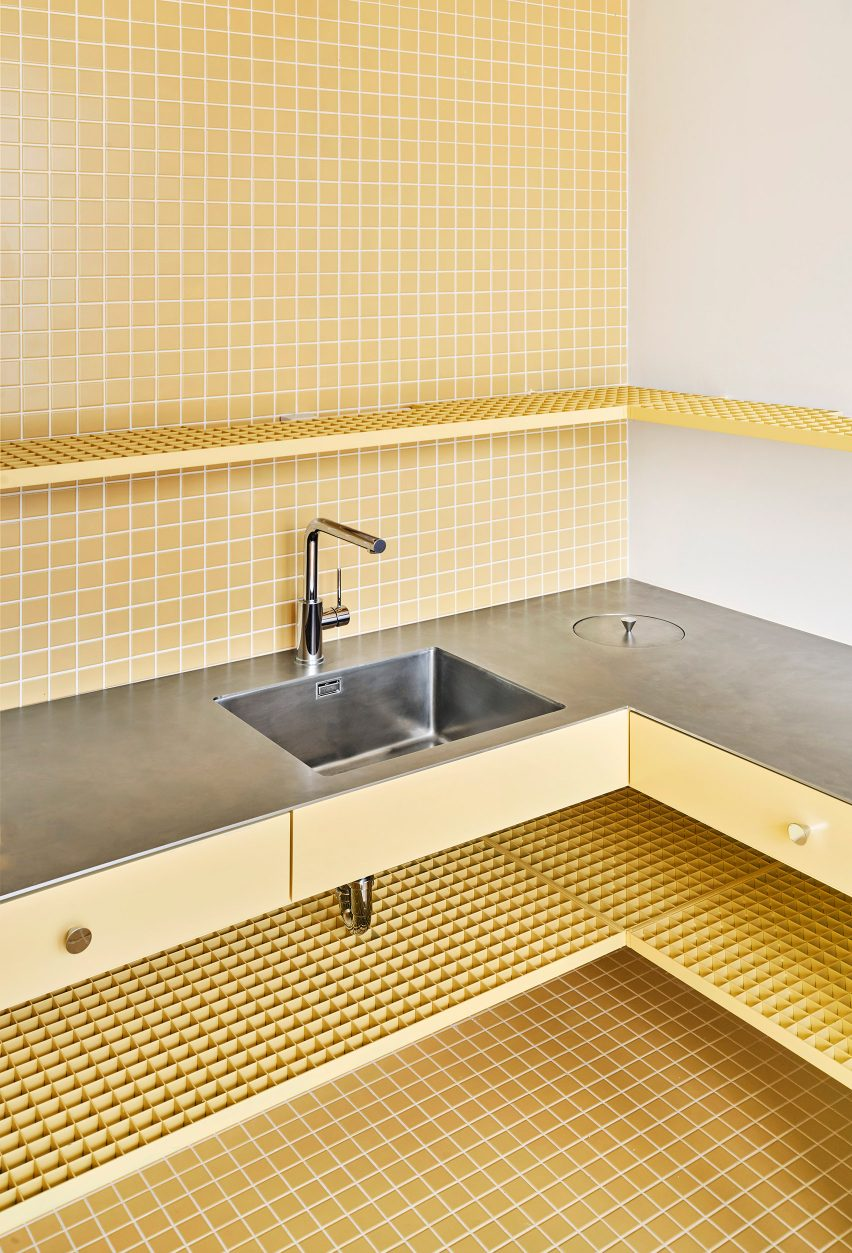 Yellow tile and steel counter kitchen