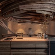 "Embers restaurant in Taipei features a ""vortex"" of cedar planks"