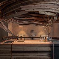 "Embers restaurant in Taipei features a ""vortex"" of cedar planks"