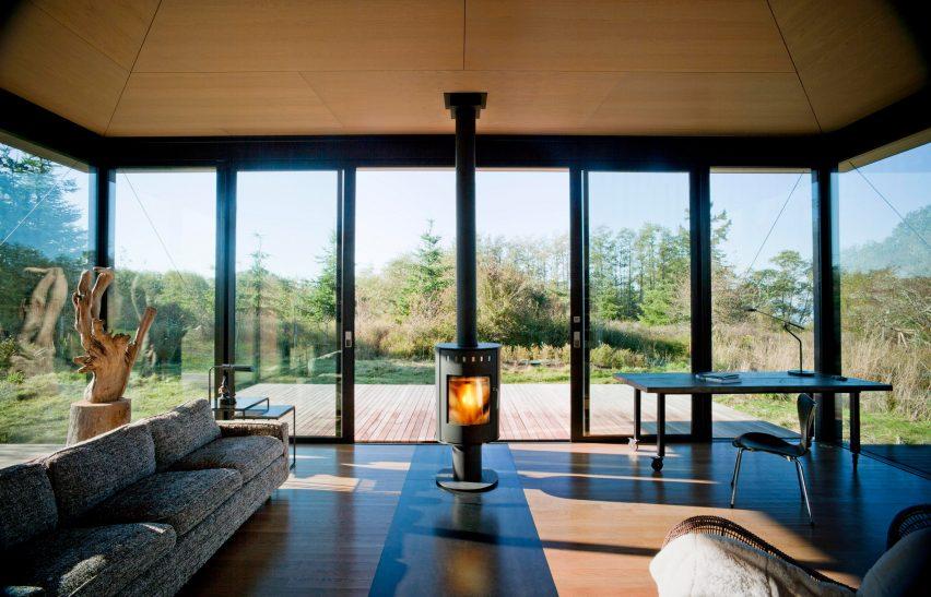 Fireplace inside False Bay Writer's Cabin by Olson Kundig