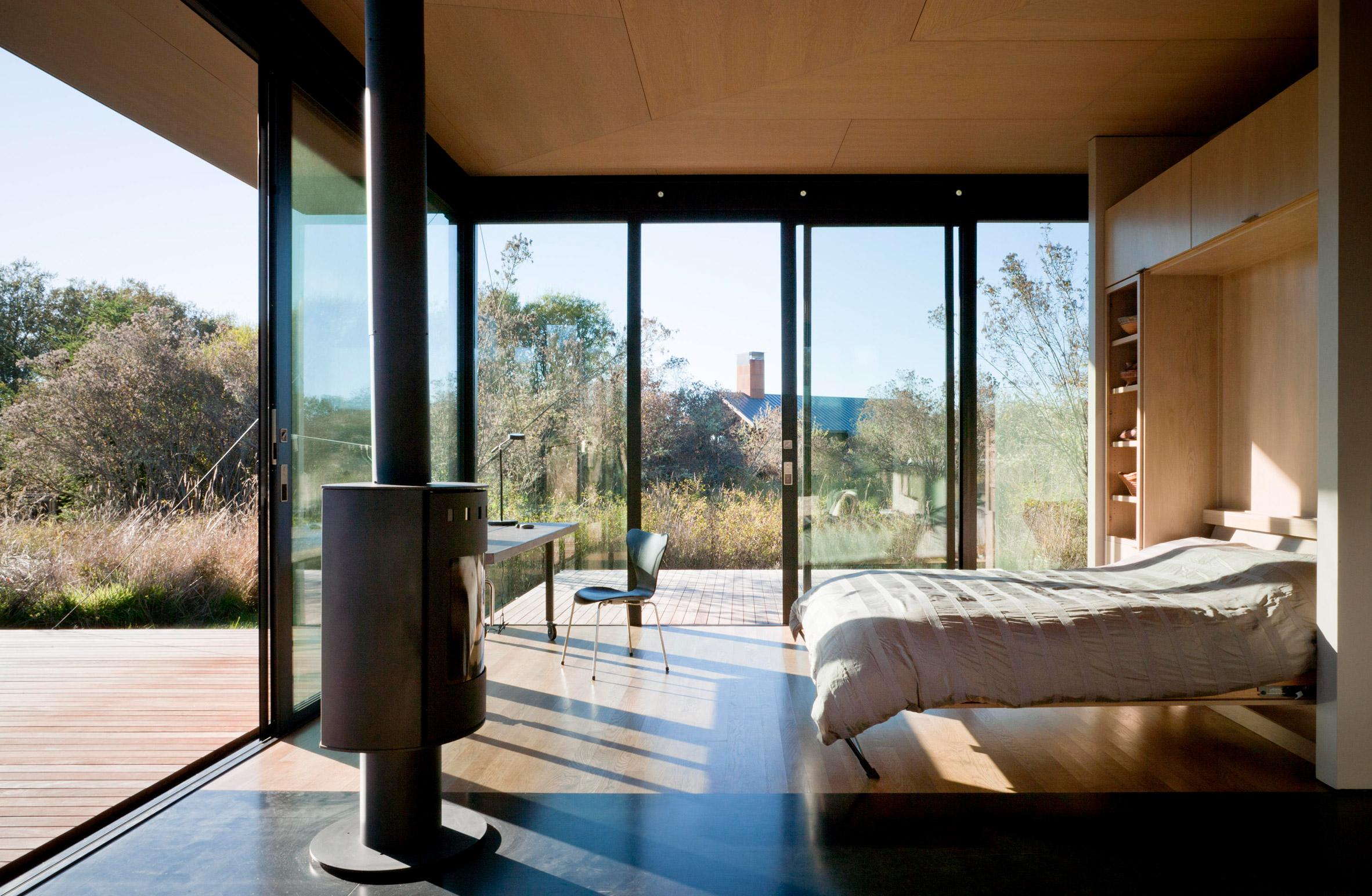 Bed folds down inside False Bay Writer's Cabin by Olson Kundig