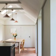 Terracotta tiles add warmth to Wiltshire farmhouse kitchen by Emil Eve Architects