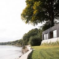 Norm Architects creates black-timber retreat near border of Denmark and Germany