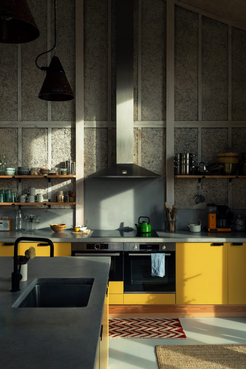 Kitchen with hemp walls and yellow cupboards