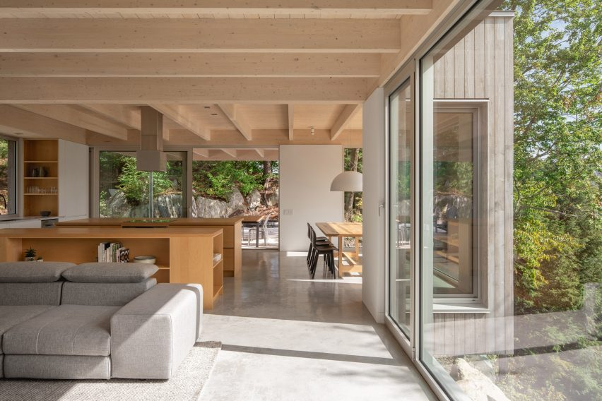 Living spaces in Forest House I by Natalie Dionne Architecture