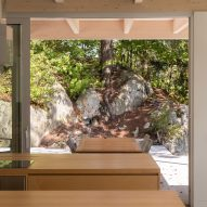 View through window of Forest House I by Natalie Dionne Architecture