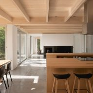 Maple kitchen islands in Forest House I by Natalie Dionne Architecture