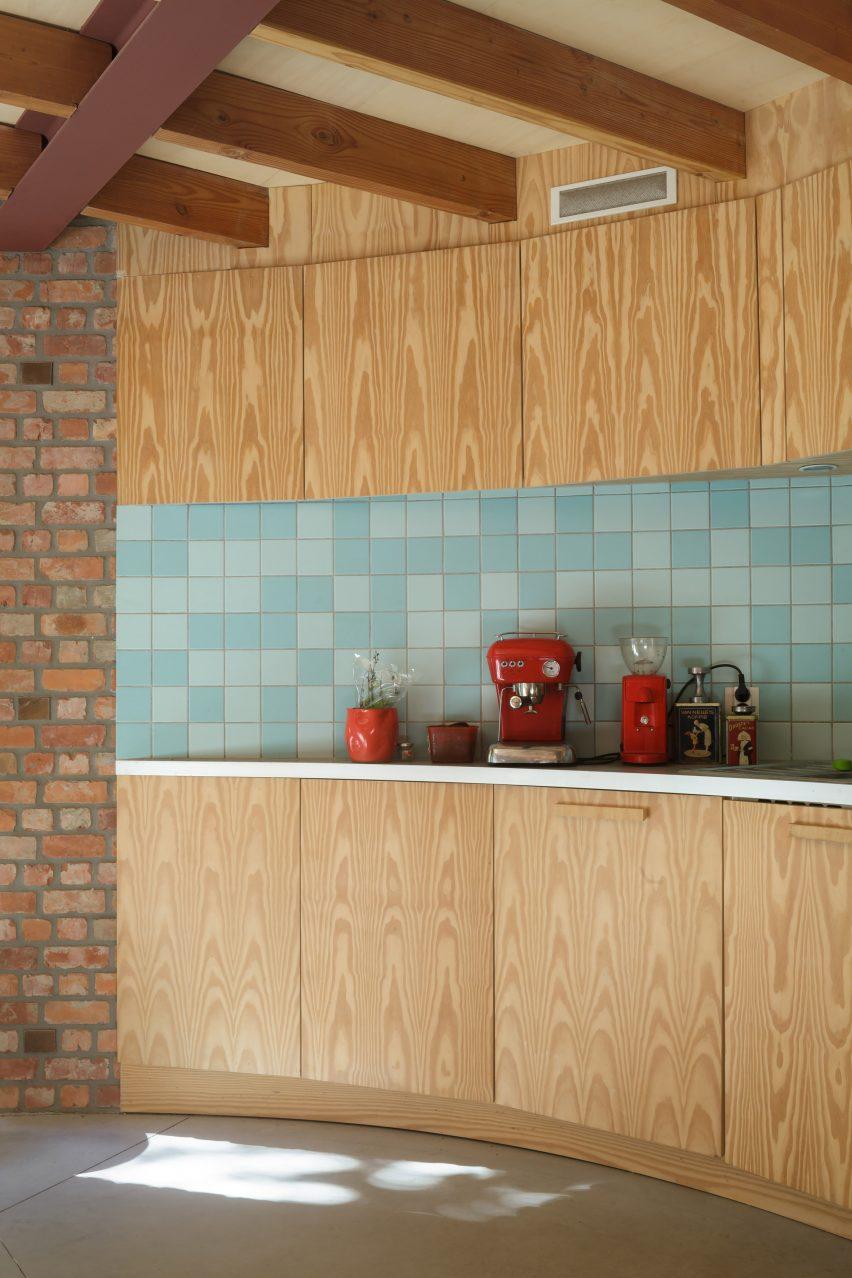 Kitchen of GjG House built of reclaimed bricks by BLAF Architecten in Ghent, Belgium