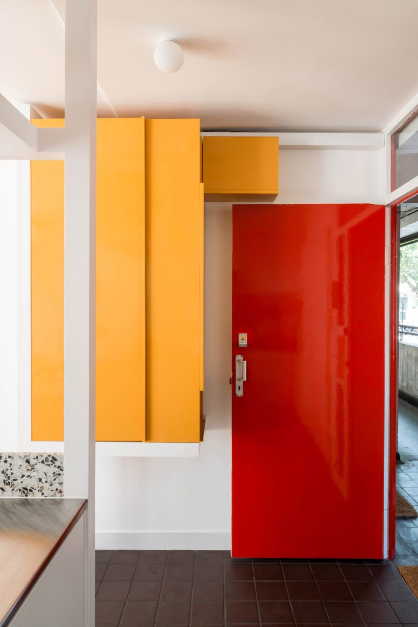 Red front door at Golden Lane flat by Archmongers