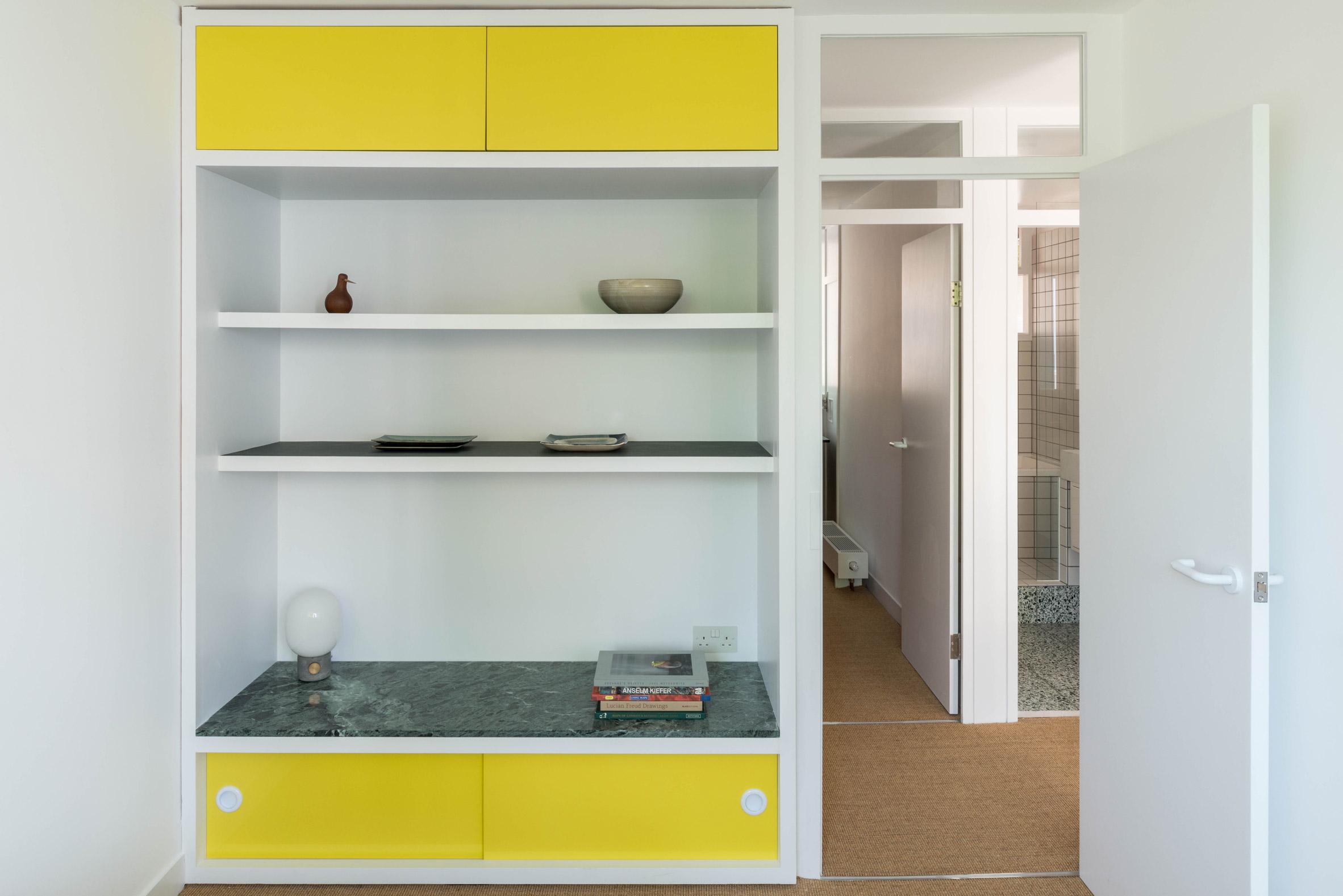 Bedroom shelving Golden Lane flat by Archmongers