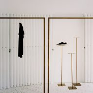 Geometric display hangers in Grifo210 boutique by Paritzki & Liani Architects