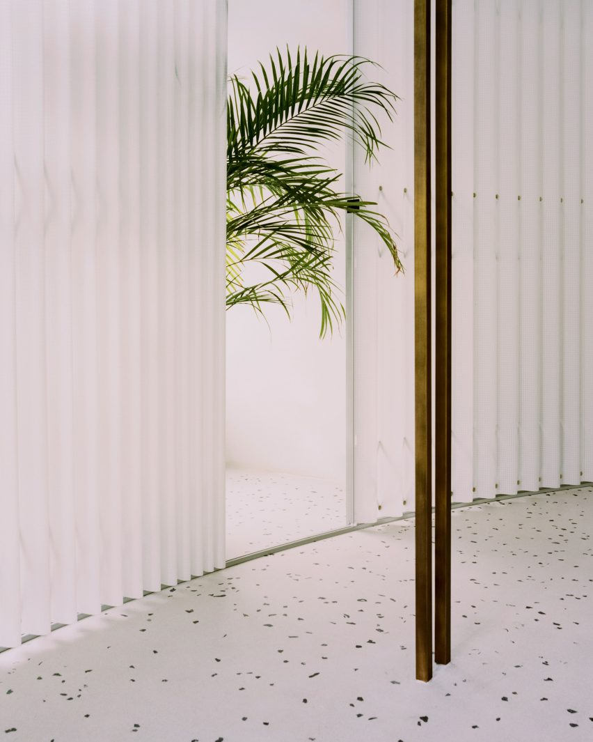 Exotic plants, white curtains and metal display hanger