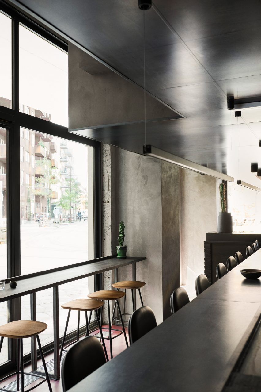 Open kitchen dining at Hija de Sanchez Cantina by OEO Studio