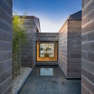 Hooba Design Group arranges concrete showroom in Iran around fish pond and greenery