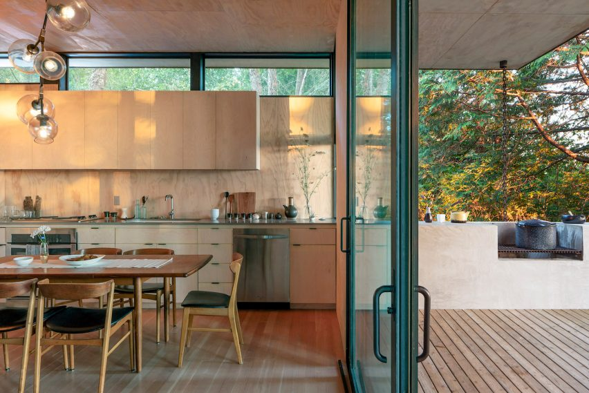 Kitchen with pass-through window onto outdoor grill deck