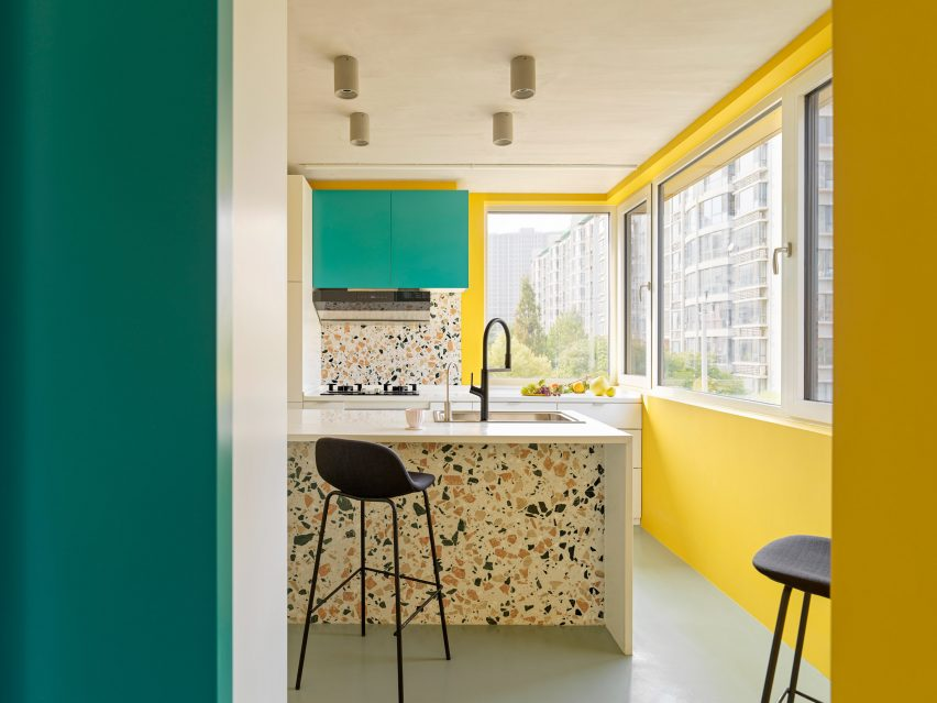 Yellow, teal and terrazzo kitchen