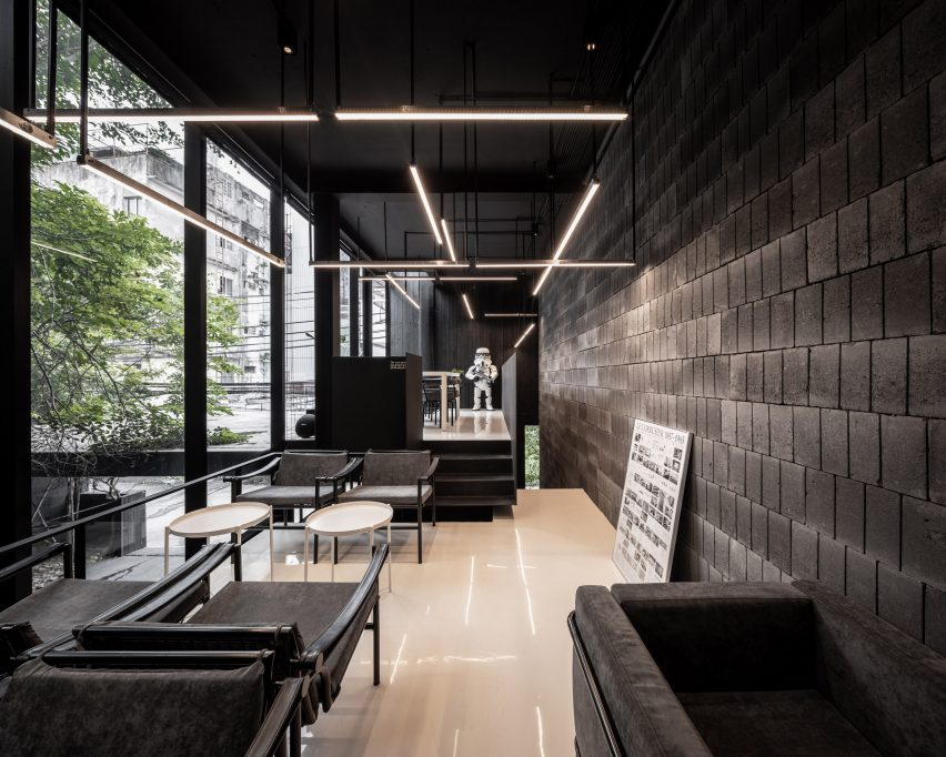 Black interiors of IDIN Architects Office in Bangkok, Thailand