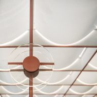 Ceiling of Infinity Wellbeing spa in Bangkok has copper detailing