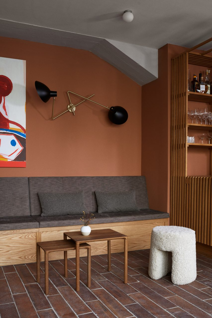 Terracotta-coloured lounge in Kadeau Copenhagen by OEO Studio