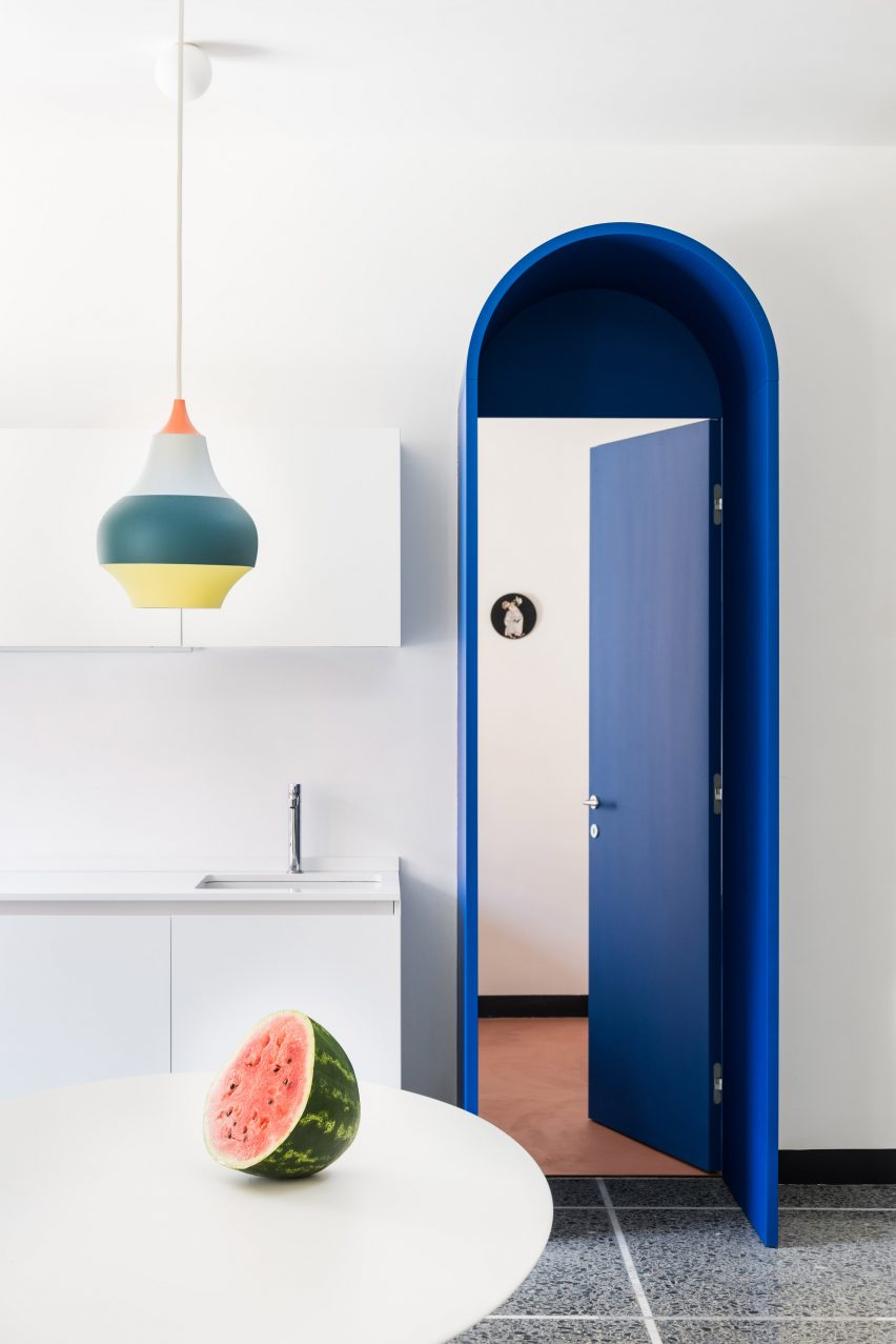 Doorway in Retroscena apartment renovation by La Macchina Studio in Rome, Italy