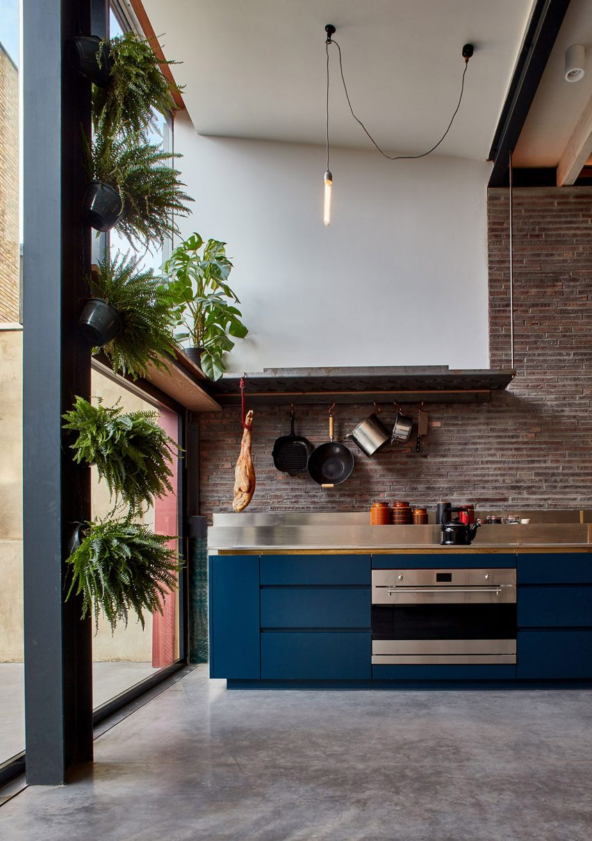 Exposed brick and steel kitchen extension