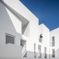 Bright white walls contrast historic facade of MM34 apartments in Mexico City