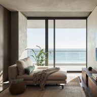 MW Works uses dark wood and sandy walls for interiors of Ocean Drive apartment in Miami Beach