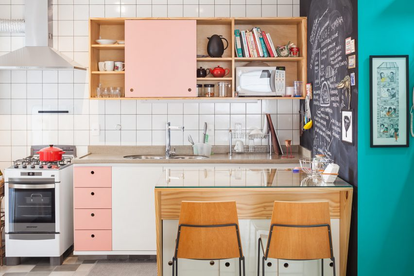 White tile and pink cabinet kitchen