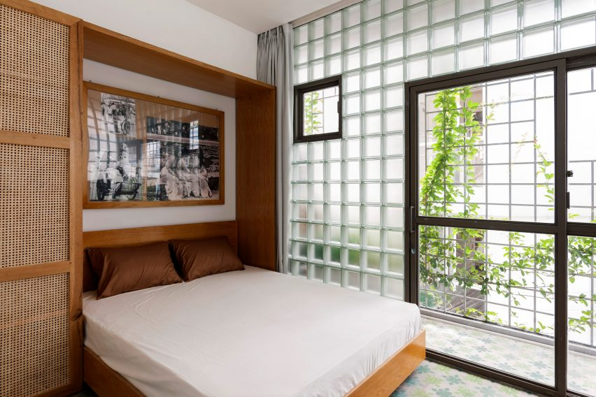 Master bedroom has glass brick walls
