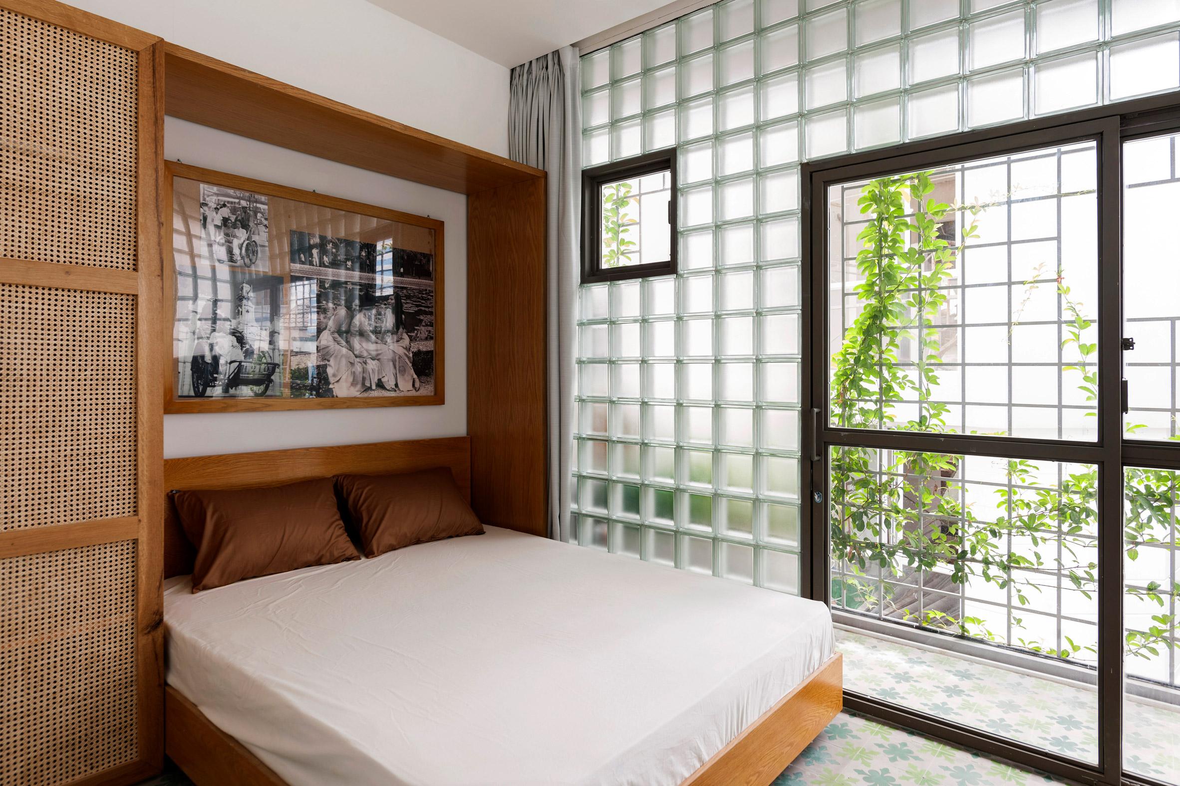 Master bedroom has glass brick walls