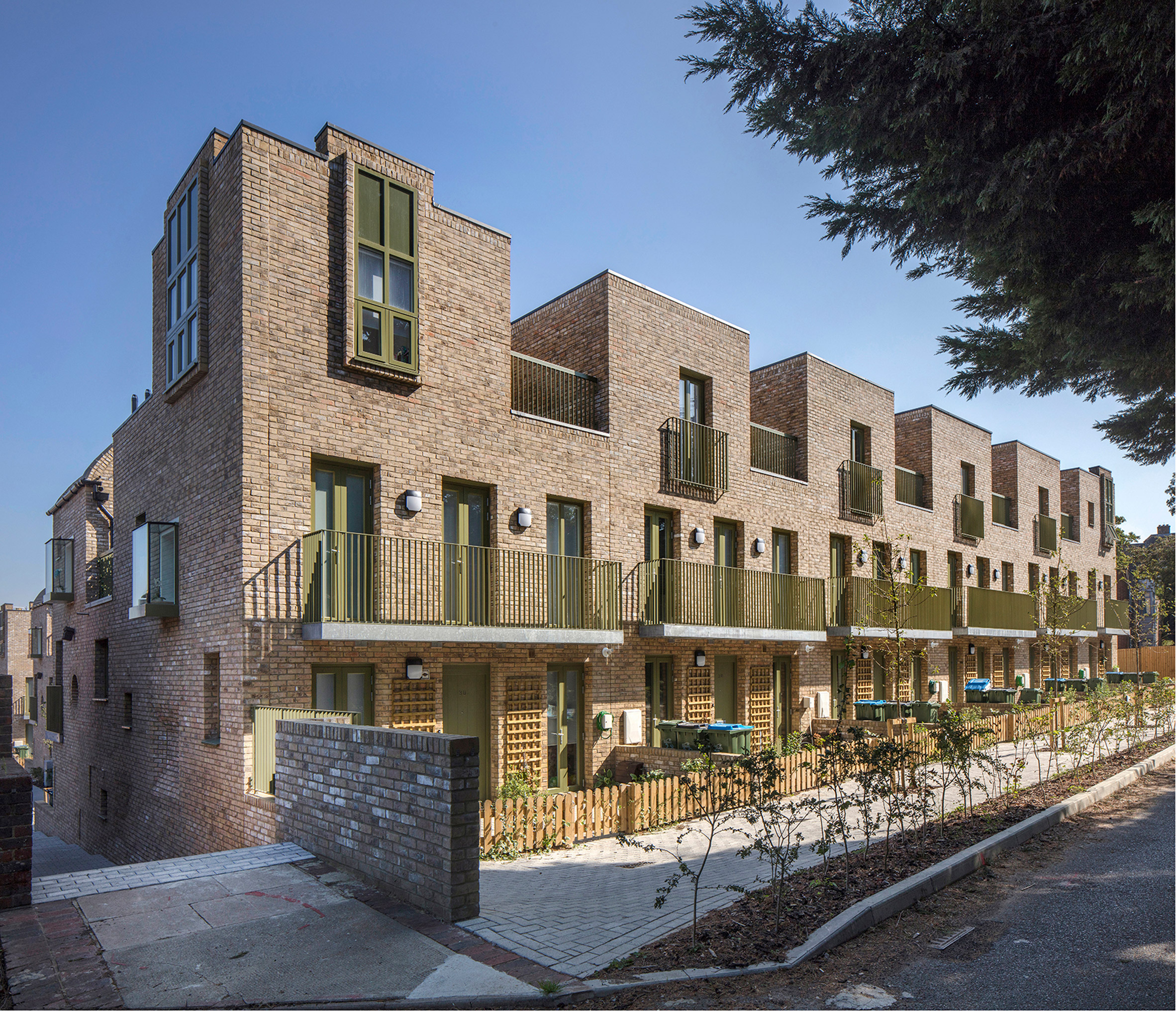 Front gardens in Peter Barber Architects housing