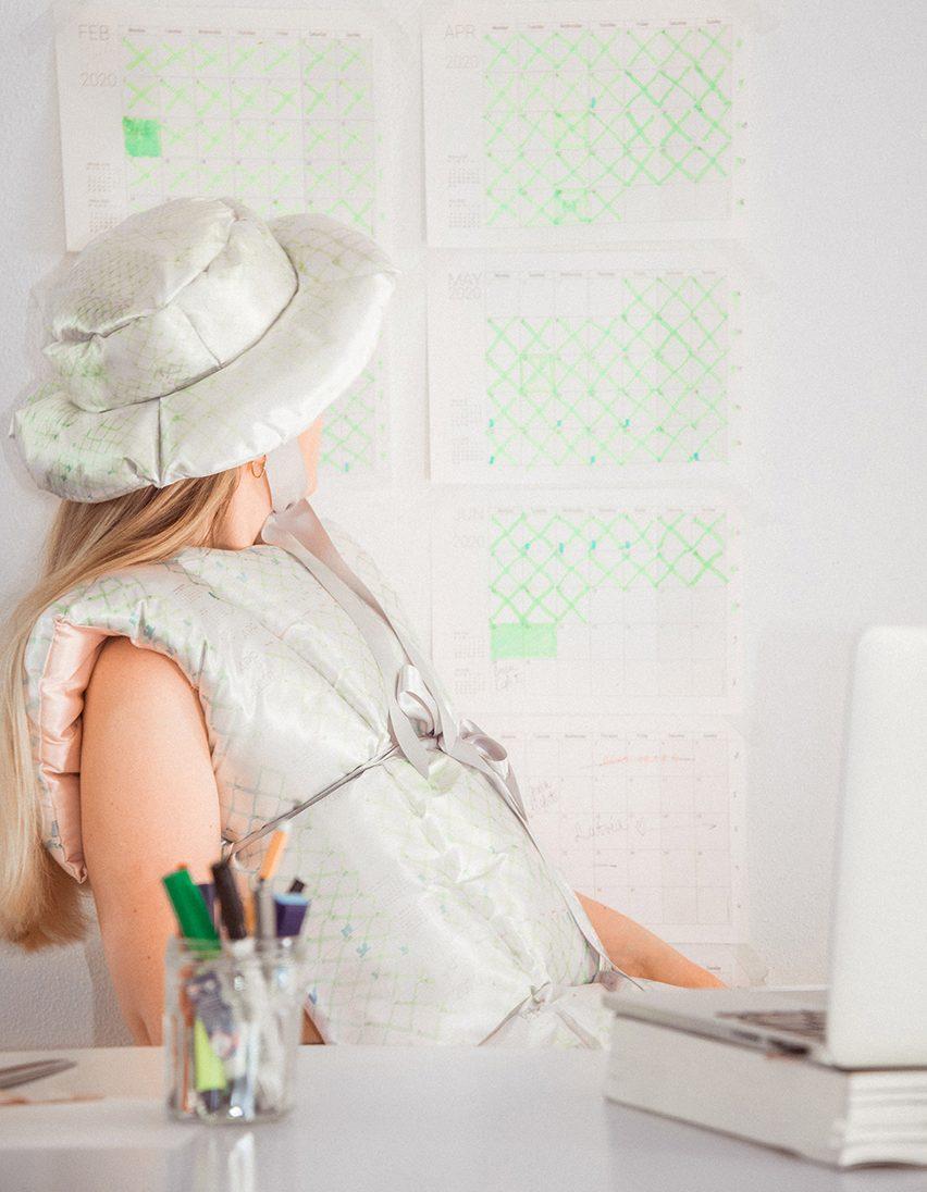 Santa Kupča wearing her Public Library duvet-style garment and hat