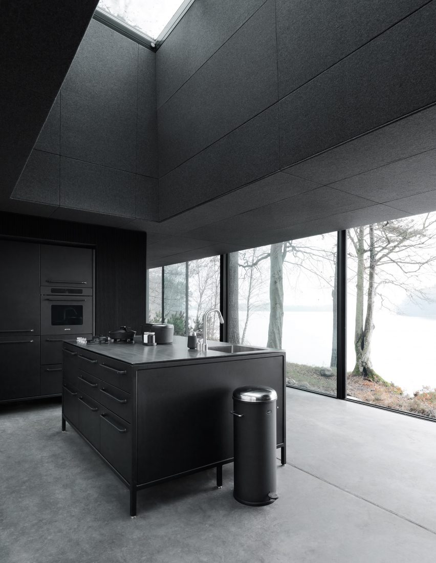 All-black kitchen in a prefab cabin