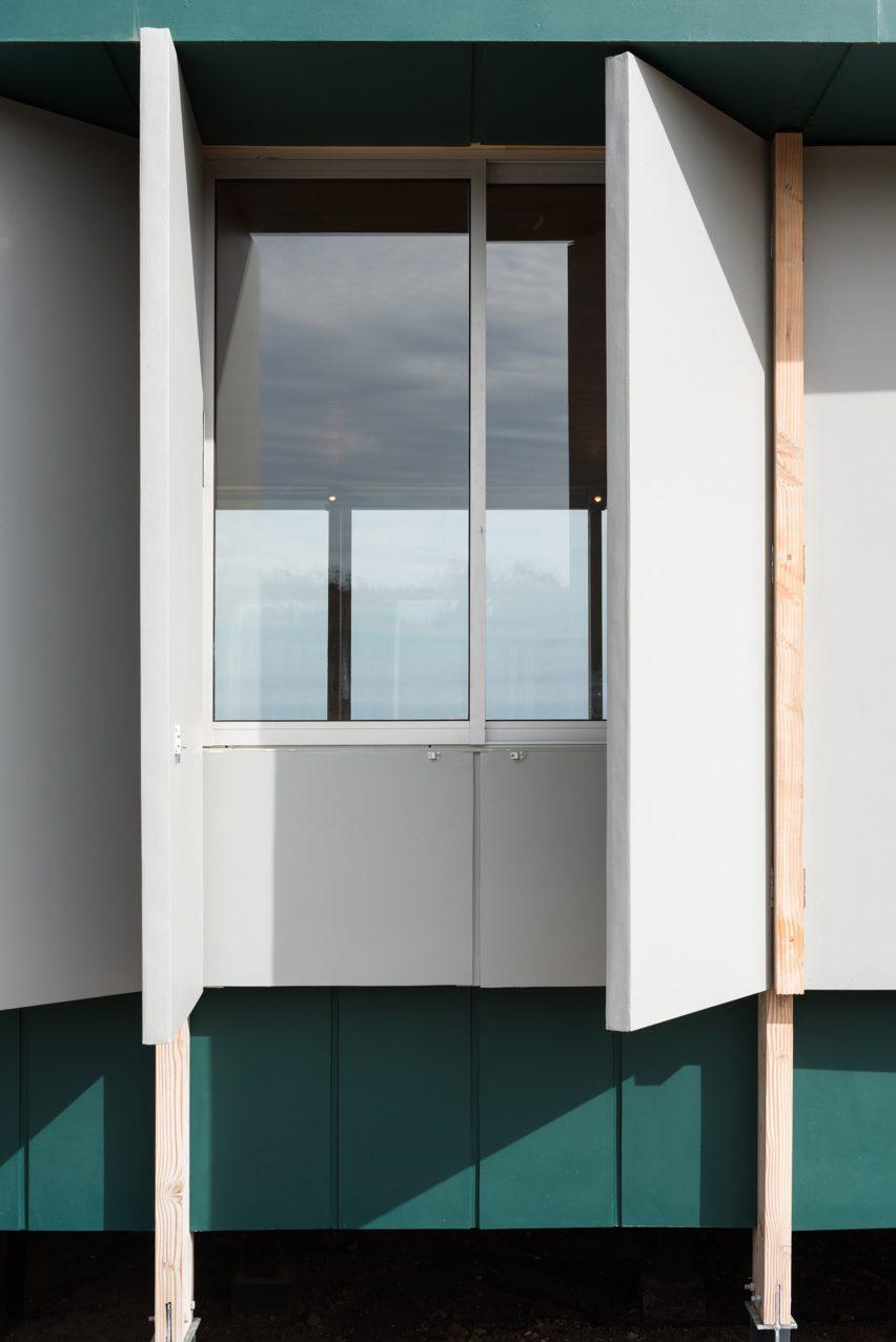 Window shutters outside of SP House by (E)StudioRO in Chile