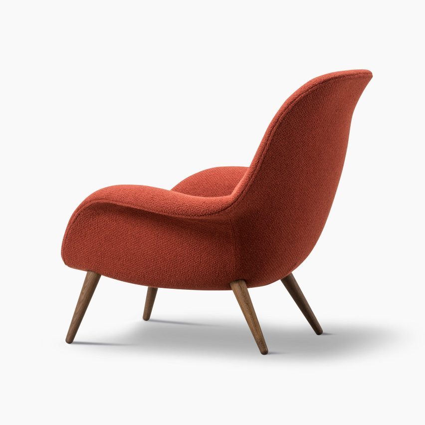 A Swoon lounge chair with wooden legs by Space Copenhagen for Fredericia