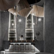 Daosheng Design creates monochromatic bar with looping bamboo sculpture