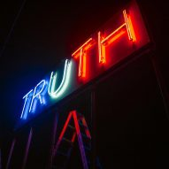 Stefan Brüggemann installs TRUTH/LIE neon lights at US-Mexico border on election day