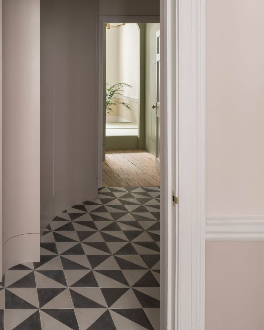 Tiled corridor of Upper Wimpole Street apartment by Jonathan Tuckey Design