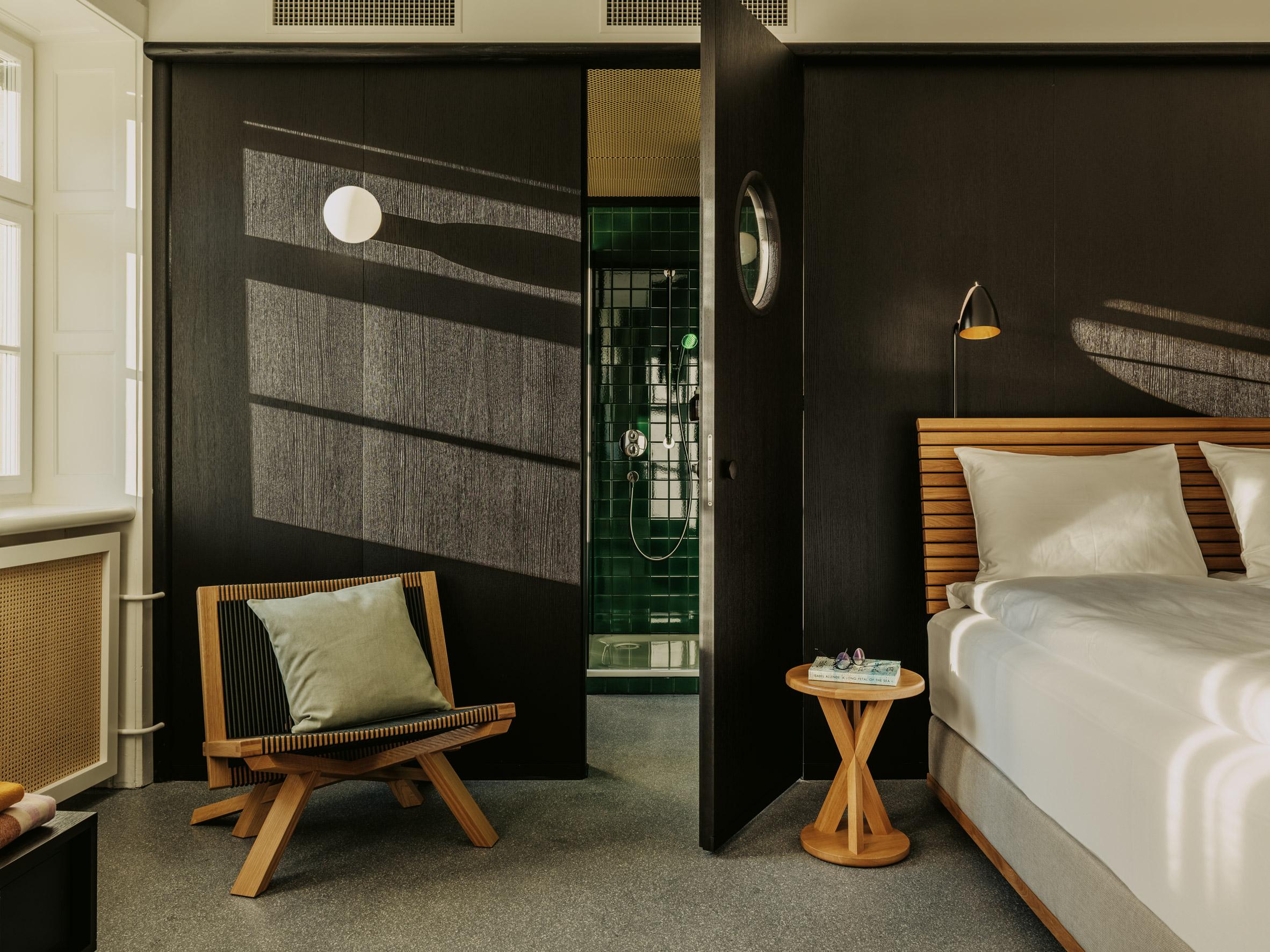 Stained black oak in bedroom of Volkshaus Basel Hotel by Herzog & de Meuron