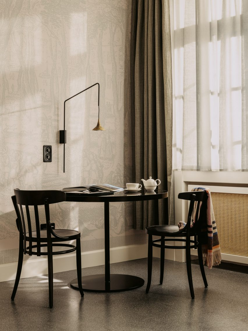 Volkshaus chairs in bedroom of Volkshaus Basel Hotel by Herzog & de Meuron
