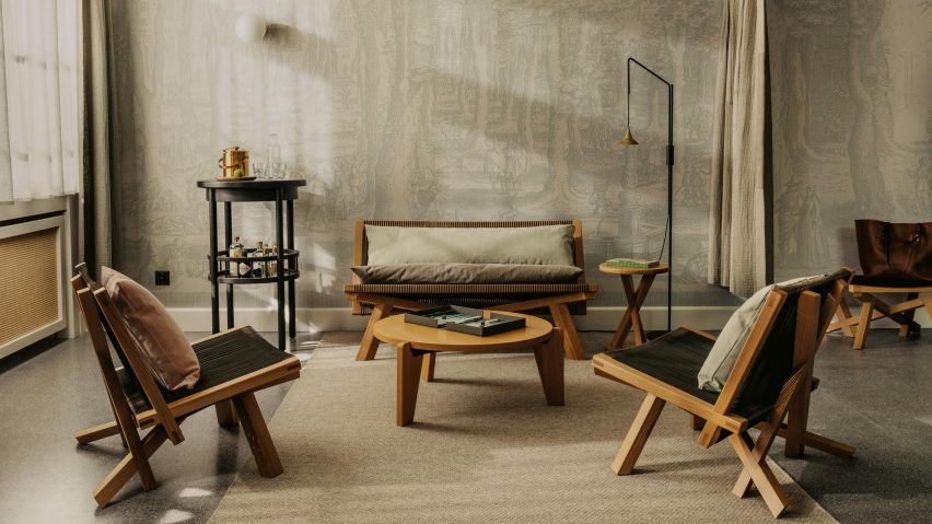 Lounge chairs in bedroom of Volkshaus Basel Hotel by Herzog & de Meuron