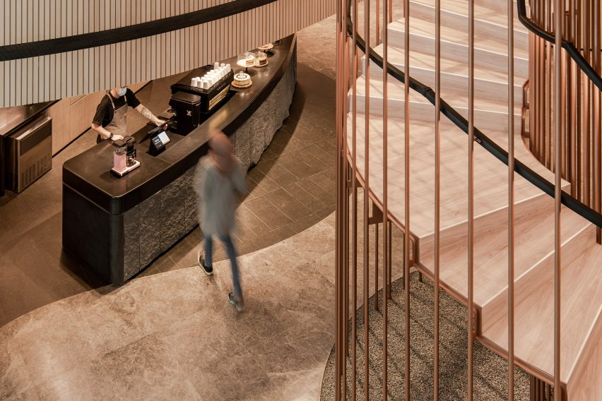 The cafe and staircase by Ministry of Design inside YTL Headquarters in Kuala Lumpur