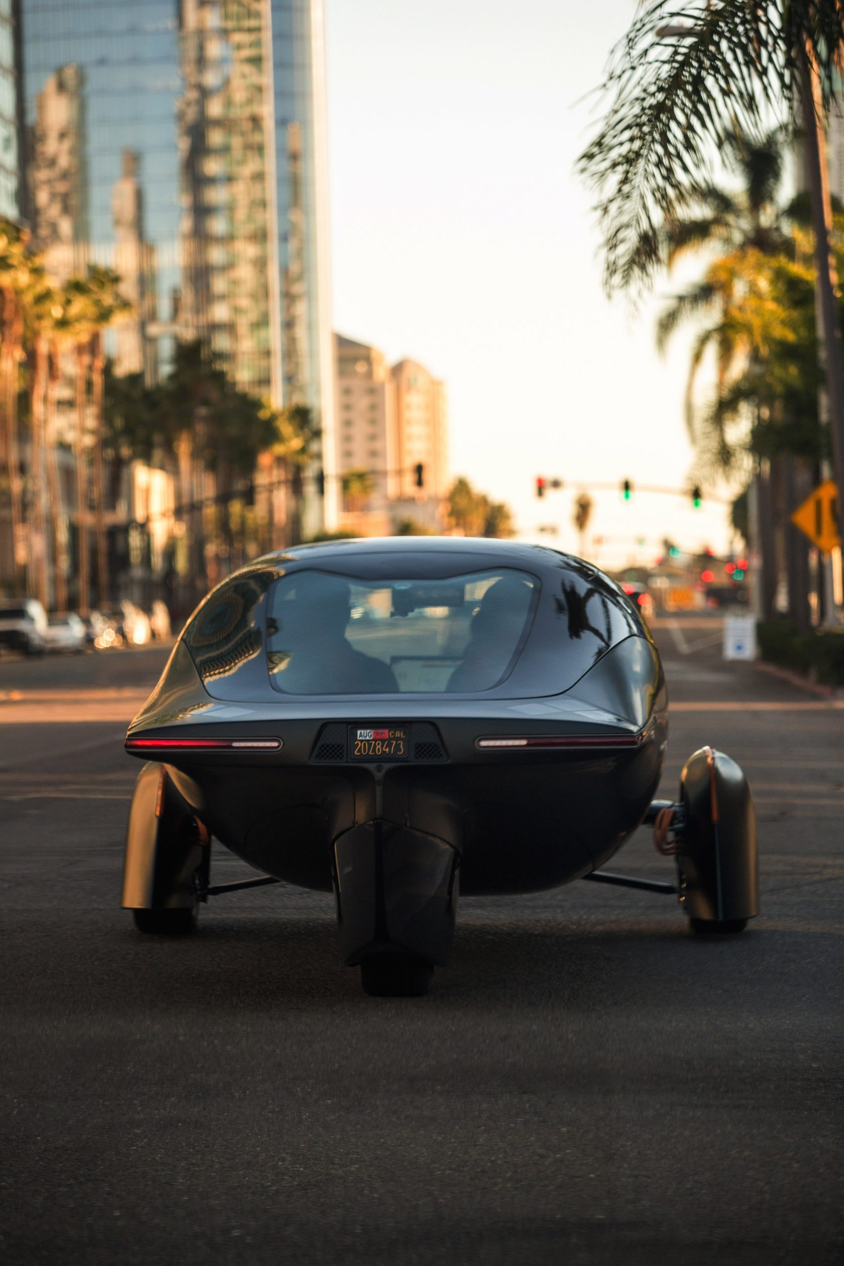 Rear view of the three-wheeled solar and electric Aptera vehicle