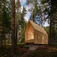 Ortraum Architects builds cosy woodland cabin from cross-laminated timber